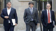 Oriol Junqueras, Carles Puigdemont y Jordi Turull. (Foto: EFE)