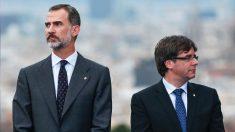 Felipe VI y Carles Puigdemont. (Foto: AFP)