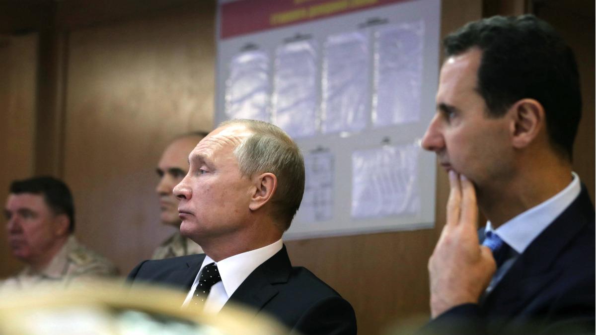 Los presidentes ruso, Vladimir Putin, y sisrio, Bashar al Assad, en la visita del primero a Siria. (AFP)