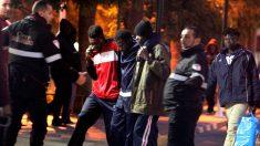 Inmigrantes tras el salto a la valla de Melilla (Foto: Efe).
