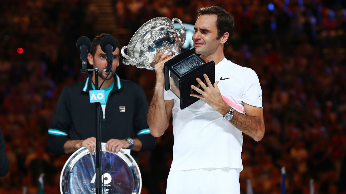 Roger Federer levanta emocionado su vigésimo Grand Slam. (Getty)