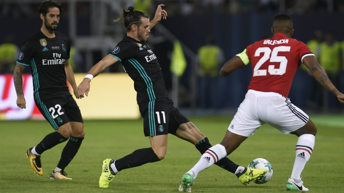 Isco y Bale durante la Supercopa de Europa ante el United. (AFP)