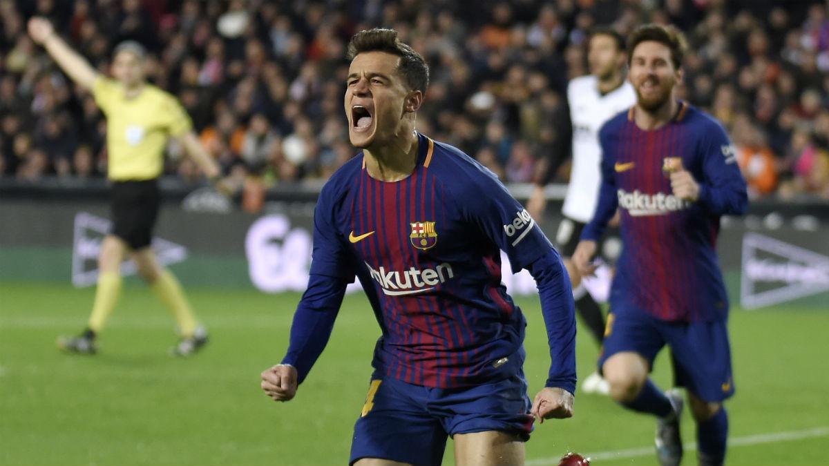 Coutinho celebra un gol al Valencia. (AFP)
