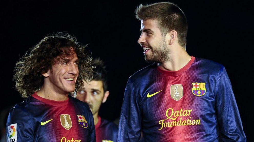 Puyol y Piqué durante un partido con el Barcelona. (Getty)