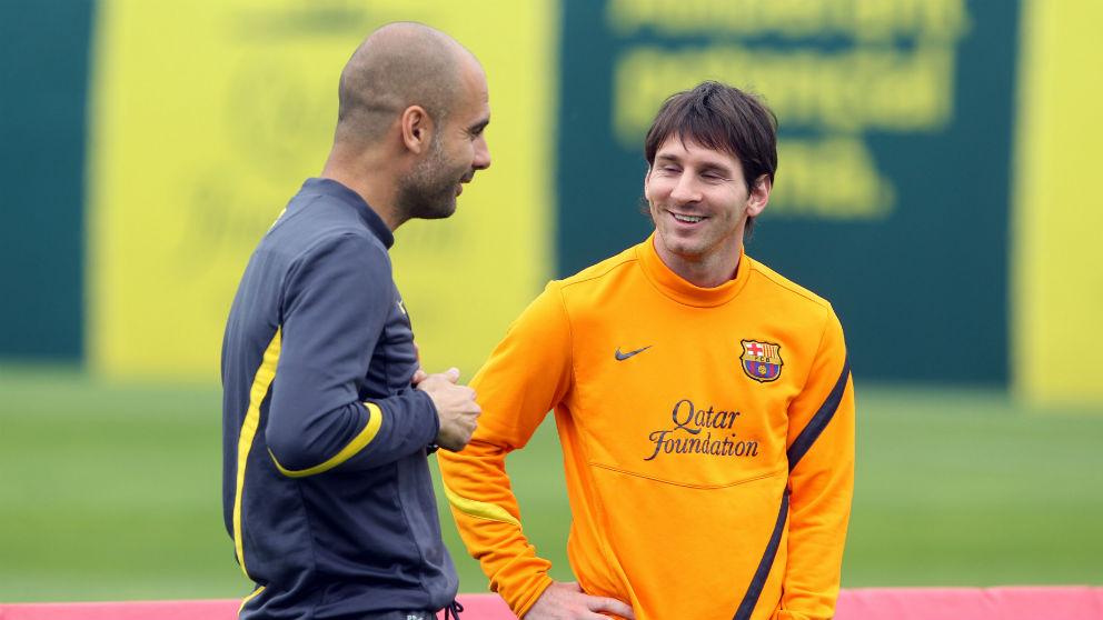 Pep Guardiola y Leo Messi, durante un entrenamiento con el Barcelona. (AFP)