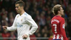 Cristiano y Griezmann durante el derbi del Wanda. (AFP)