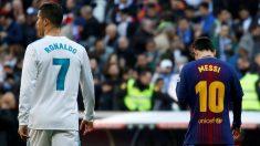 Cristiano Ronaldo y Messi, durante el último Clásico (AFP).