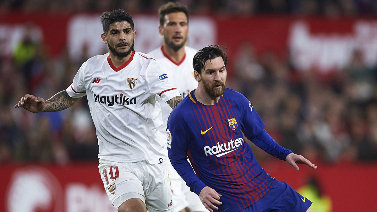 Ever Banega y Leo Messi durante un Sevilla – Barcelona. (Getty)
