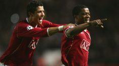 Cristiano Ronaldo y Patrice Evra celebran un gol en el Manchester United. (Getty)
