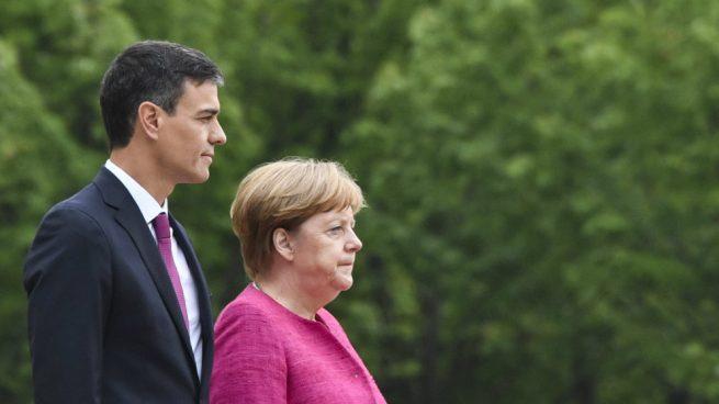 Pedro Sánchez y Angela Merkel. Foto: AFP