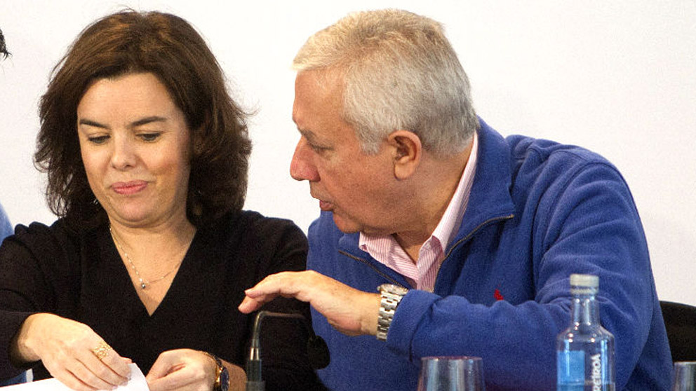 Soraya Sáenz de Santamaría y Javier Arenas.