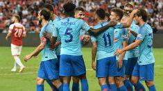 Los jugadores del Atlético celebran el gol de Vietto frente al Arsenal. (AFP)