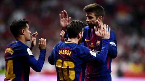 Messi, Piqué y Coutinho celebran un gol. (Getty)