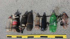 Una botellas, con ácido de baterías de coches y cal viva, usadas por los inmigrantes en el salto de la valla de Ceuta.