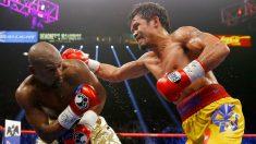 Floyd Mayweather y Manny Pacquiao, en su combate en 2015. (Getty)