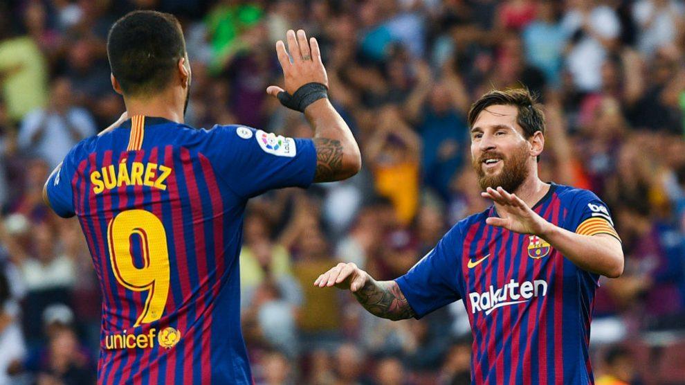 Luis Suárez y Messi celebran un gol del Barcelona. (Getty)