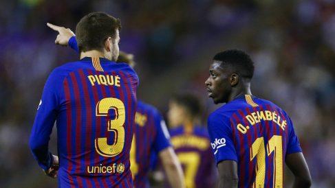 Gerard Piqué y Dembélé. (AFP)