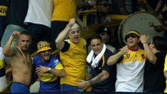 Rafael Di Zeo, con camiseta amarilla en el centro de la imagen. (AFP)