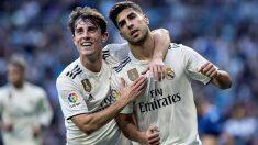 Odriozola y Asensio celebran un gol del Real Madrid. (AFP)