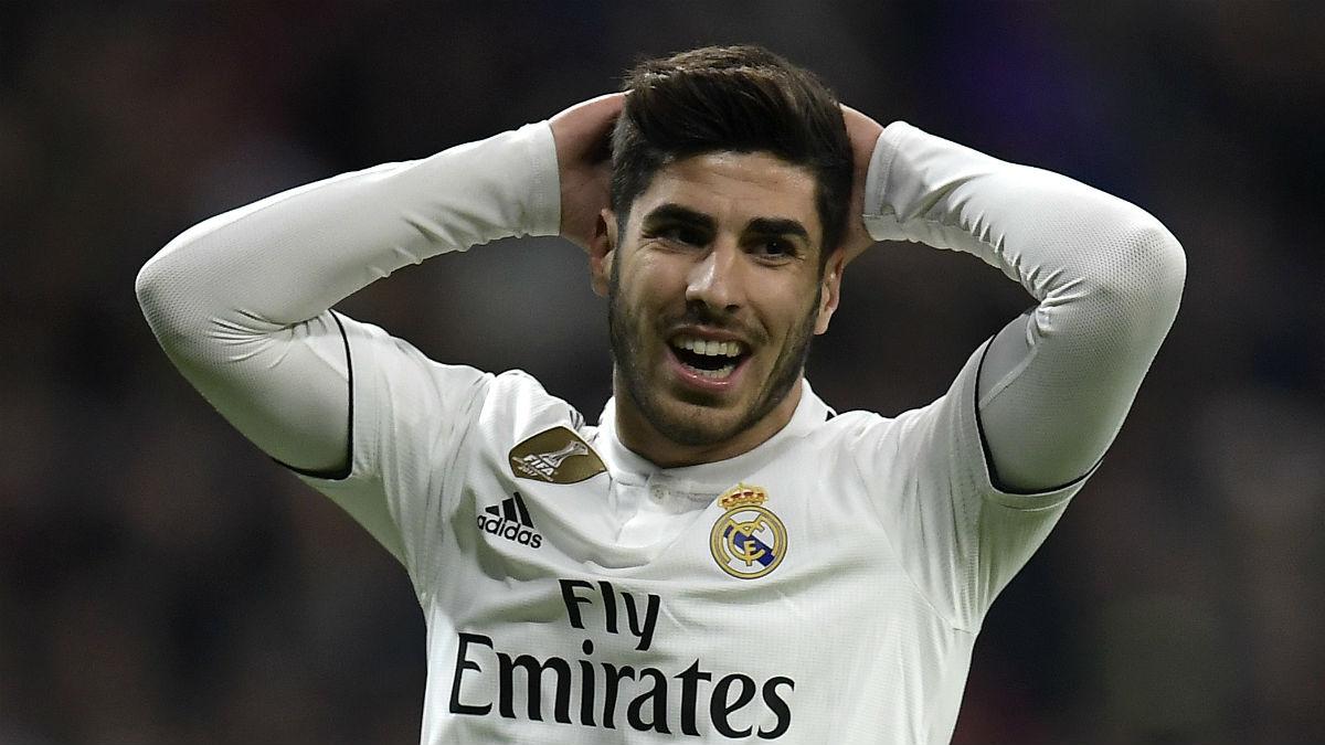 Asensio se lamenta tras fallar una ocasión con Real Madrid (AFP).