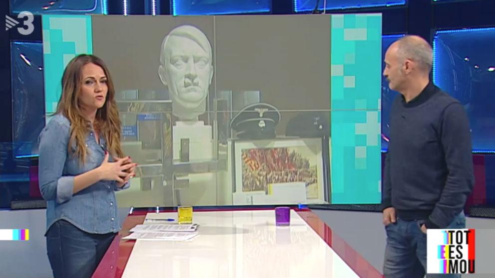 Adam Majó habla en TV3 sobre los grupos que quitan lazos amarillos, ante una imagen de Hitler.