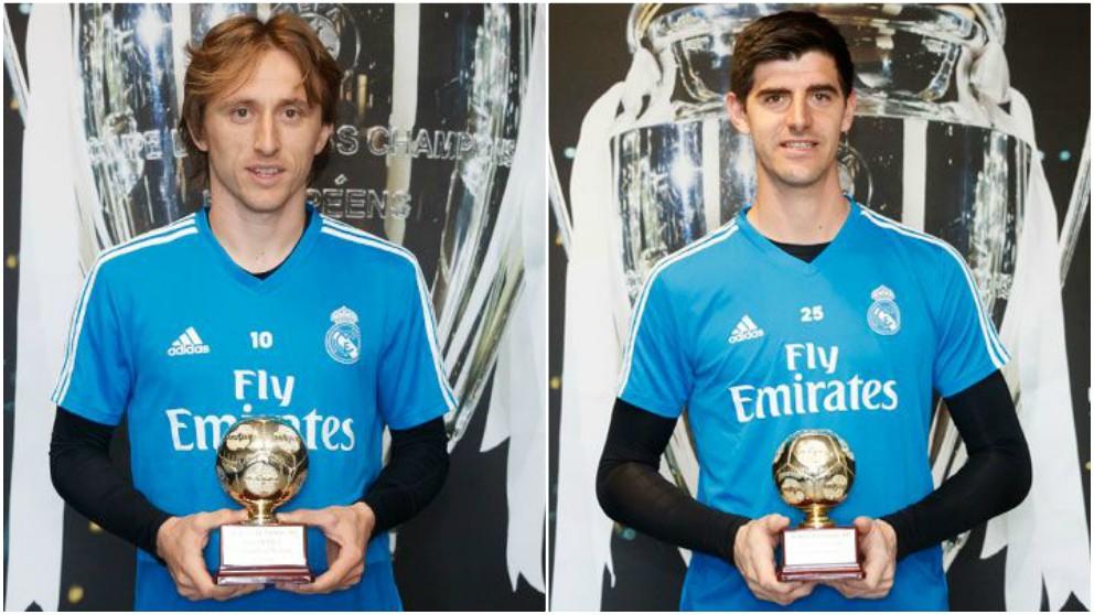 Modric y Courtois posan con los premios que coronan su 2018.