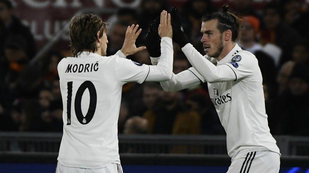 Luka Modric y Gareth Bale celebran un gol del galés en Champions. (AFP)