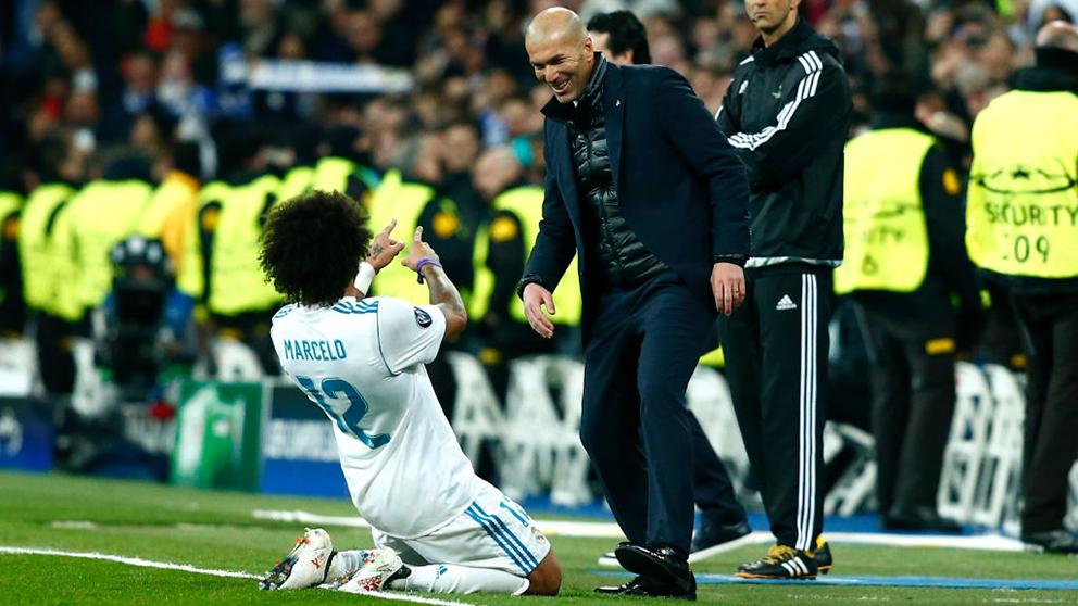 Marcelo celebra un gol junto a Zinedine Zidane. (Getty)
