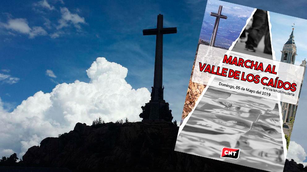 La cruz del Valle de los Caídos junto al cartel de la marcha convocada por CNT para exigir su derrumbamiento.
