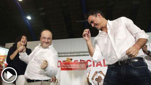 Miquel Iceta y Pedro Sánchez bailando durante un acto del PSOE