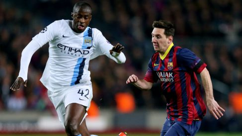 Yayá Touré y Messi, durante un partido entre el Barcelona y el City. (Getty)