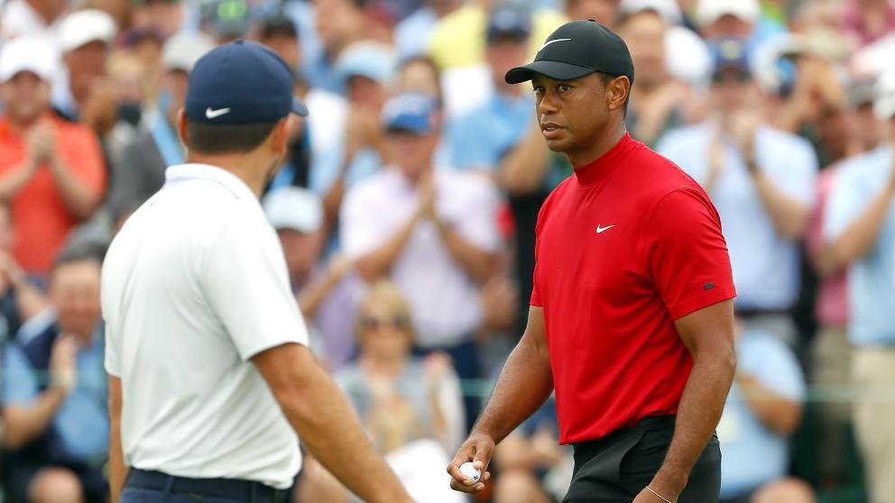 Tiger Woods junto a Francesco Molinari. (Getty)