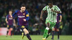 Messi y William Carvalho (AFP)