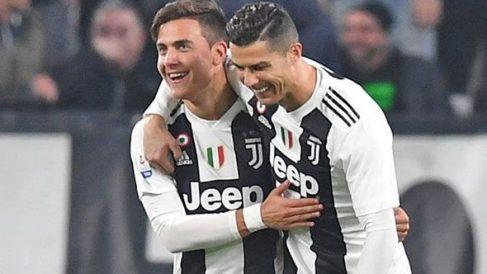 Paulo Dybala y Cristiano Ronaldo durante la celebración de un gol (Getty)