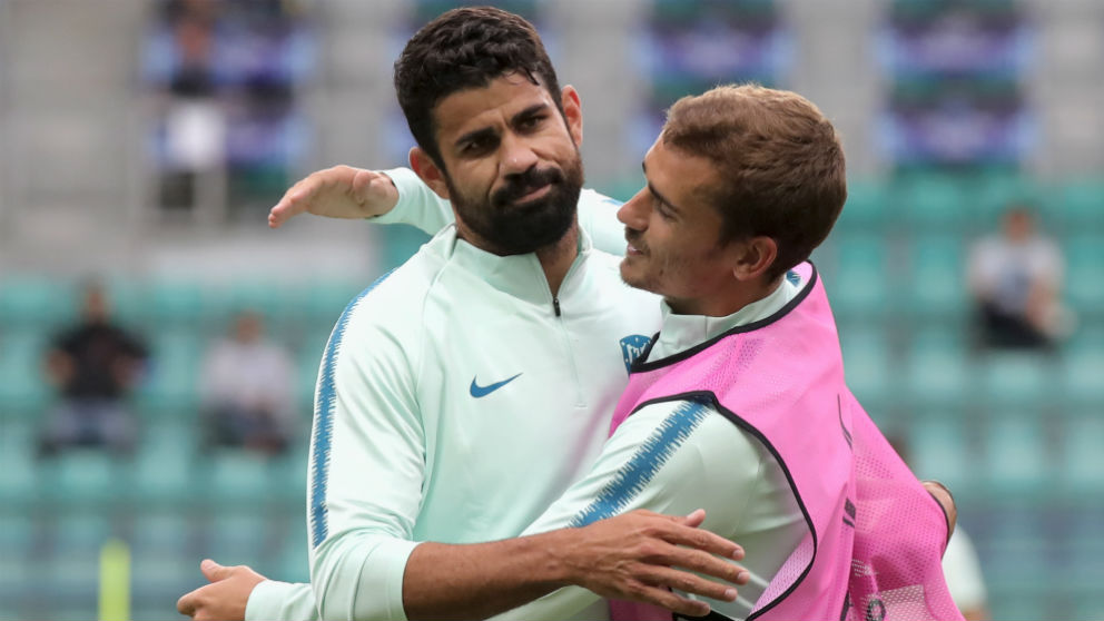 Diego Costa y Griezmann, en un entrenamiento. (AFP)
