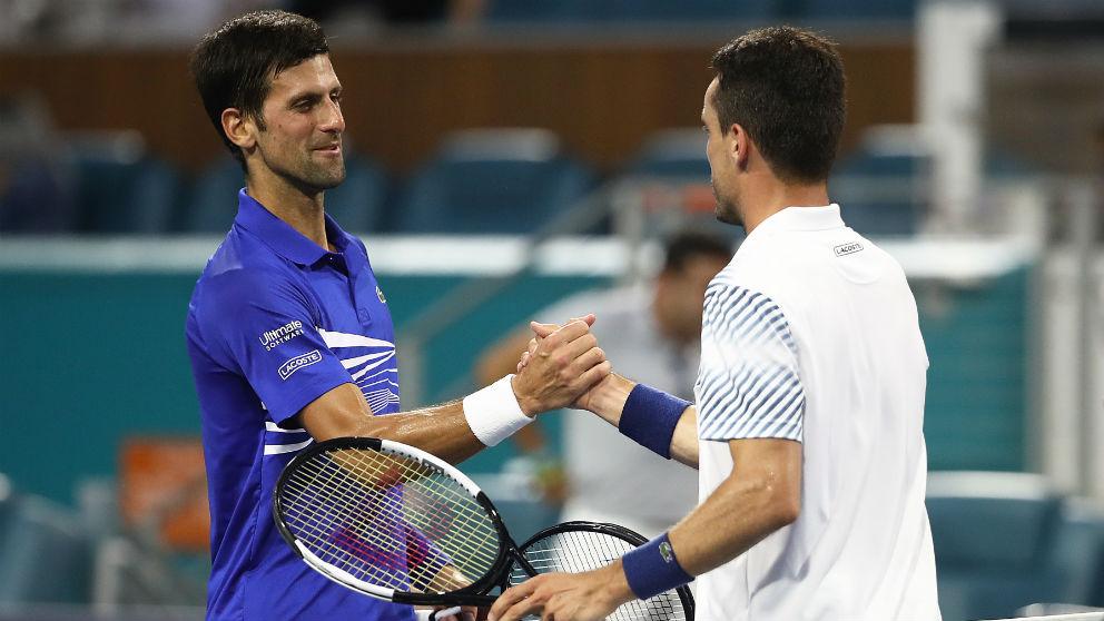 Djokovic y Bautista, en un partido en Miami. (Getty)