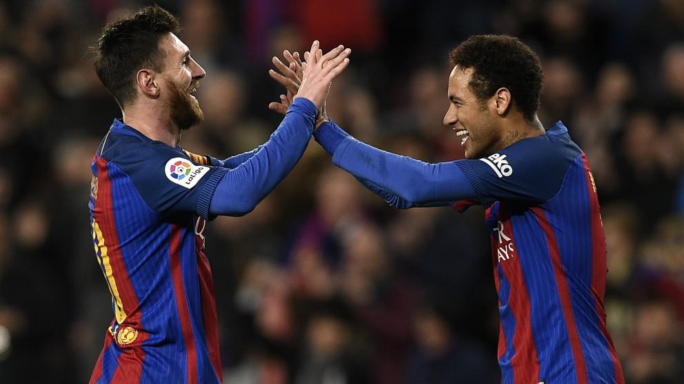 Messi y Neymar, en un partido con el Barcelona. (AFP)