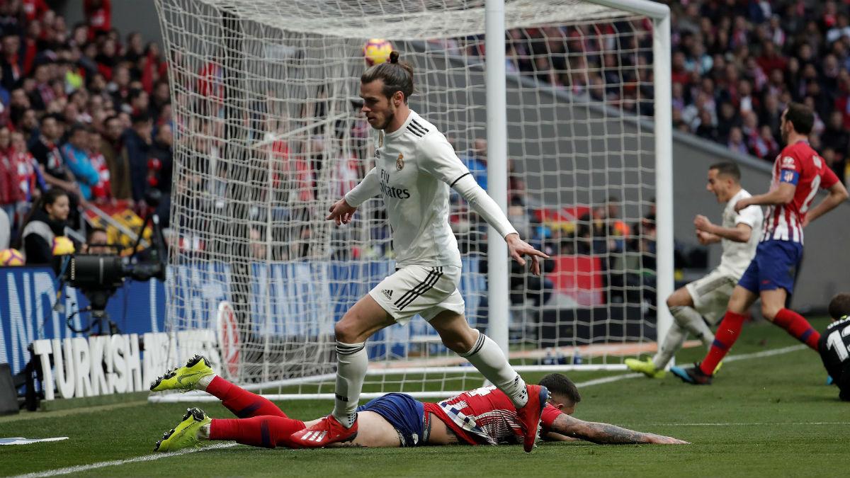Gareth Bale celebra el gol de la victoria en el último derbi disputado en el Metropolitano (Getty).