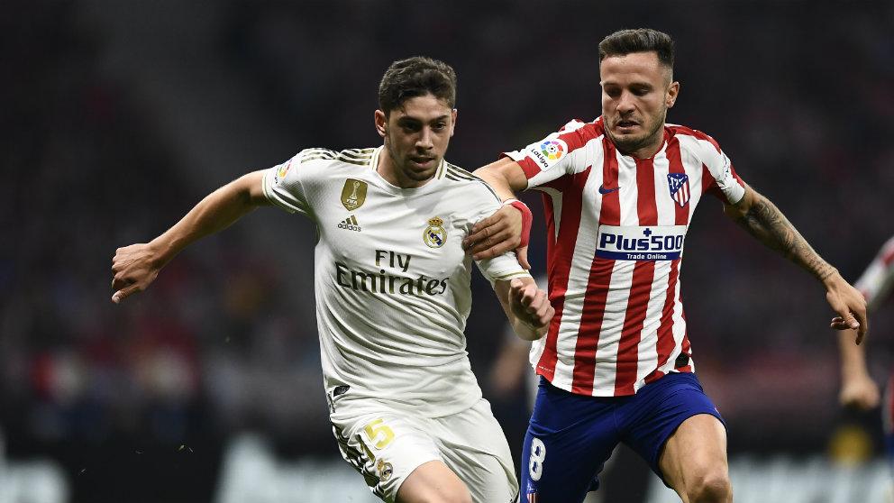Saúl Ñíguez y Fede Valverde (AFP)