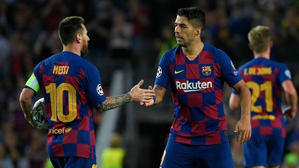 Messi y Luis Suárez celebran un gol esta temporada. (AFP)