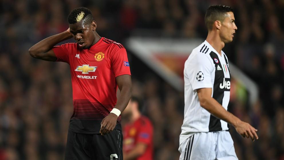 Paul Pogba y Cristiano Ronaldo en un partido entre Manchester United y Juventus. (Getty)