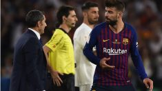 Piqué y Valverde durante un partido del Barcelona. (Getty)