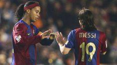 Ronaldinho y Messi, en el Barcelona. (Getty)