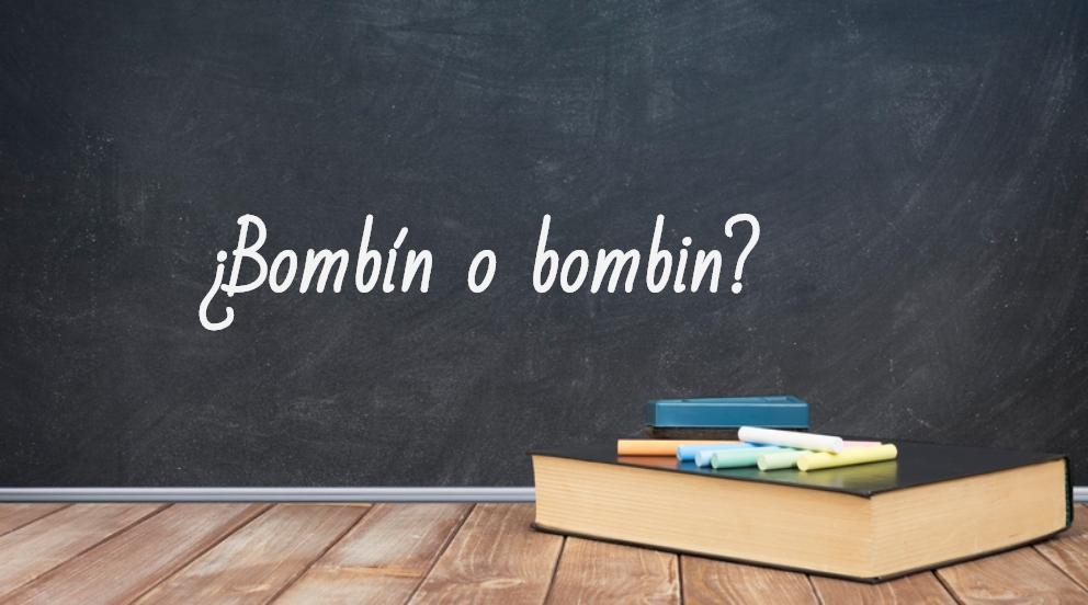 Se escribe bombín o bombin