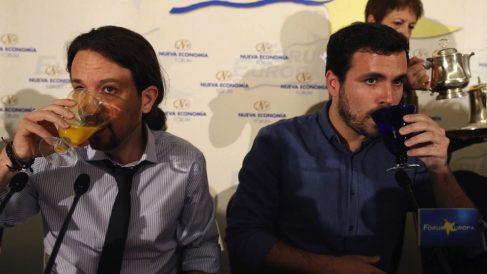 Pablo Iglesias y Alberto Garzón en un evento.