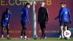 Quique Setién y Leo Messi, en un entrenamiento del Barcelona. (AFP)