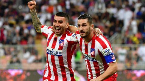 Ángel Correa y Koke celebran un gol con el Atlético. (AFP)