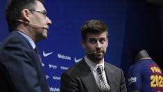 Piqué y Bartomeu, en un acto. (AFP)