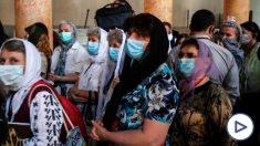 Turistas en la ciudad de Belén con mascarillas para evitar el coronavirus. (Foto. EP)