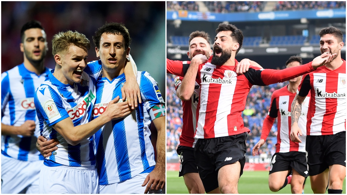 Jugadores de la Real Sociedad y el Athletic celebran un gol (Getty).